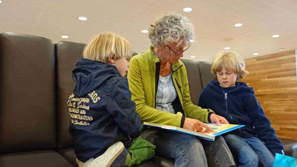 Grandma reading to kids
