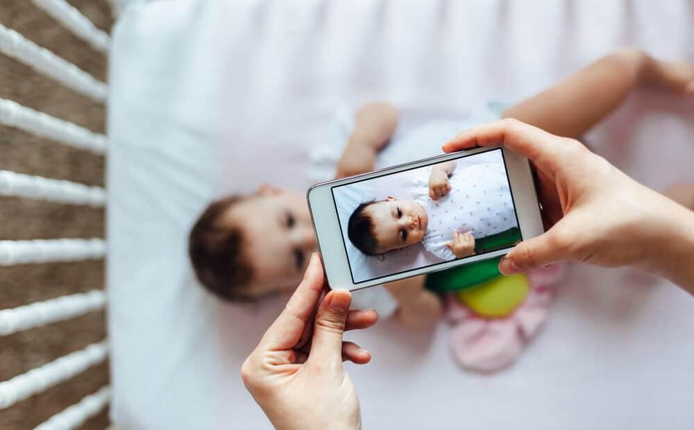 mom taking photo of baby
