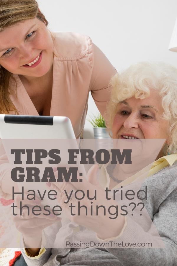 Grandma, granddaughter looking at tablet